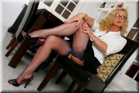 Leggy business lady Gina posing in stockings