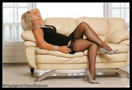 Busty Amazing Astrid in stockings teasing shaved pussy