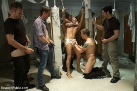 Hot stud gets pissed on and gang fucked in a public restroom