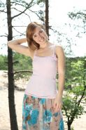 Hairy petite amateur teen Angie showing off unshaven muff outdoors