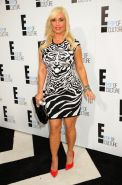 Nicole Coco Austin showing her rounded curveas in tiger printed mini dress at 'E