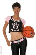 Jasmine Arabia peeling off her Basketball Uniform