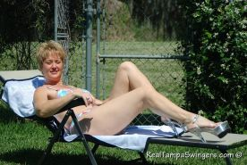 Swinger mom Tracy getting naked in the garden