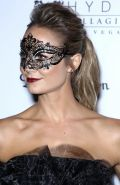 Stacy Keibler in sexy black dress hosting a Halloween masquerade party at Hyde B