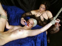 Lesbian bdsm and candle waxing domination of bound blonde slavegirl Chaos by mis