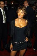 Halle Berry exposing her nice big tits and posing sexy in lingerie and mini skir