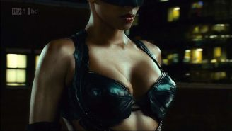 Halle Berry showing big cleavage and looking hot in outfit on movie