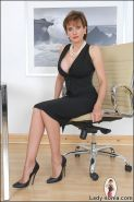 Cleavage and legs tease classy british mature wife