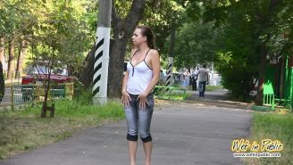 Chick in desperate pissing need wets her jeans, feet and the asphalt