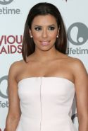 Eva Longoria busty wearing white strapless outfit at the Devious Maids premiere