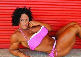 Impressive huge female bodybuilder Aleesha Young flexing her mas