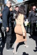 Kim Kardashian shows off her curvy body wearing tight top and skirt outside Le R