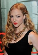 Amanda Seyfried leggy wearing little black dress at the 'Red Riding Hood' screen