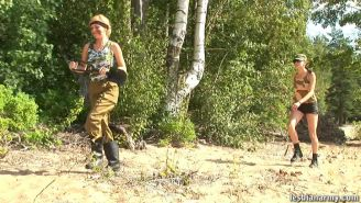 Outdoor military drilling of a nude fem swaddie