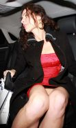 Minnie Driver flashing her bare pussy upskirt in car paparazzi pictures and posi
