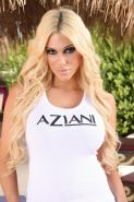 Carmel Moore takes off her Aziani top
