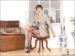 Pantyhose long legs british dominatrix lady sonia in an office