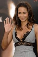 Halle Berry showing her nice big tits and posing very sexy in black lingerie