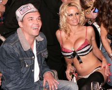 Pamela Anderson showing her nice big tits and posing in bra
