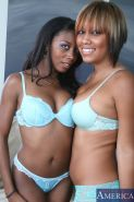 a pair of smoking hot ebony dolls share a big white dick