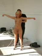 Amateur blonde sub in rope bondage in a sun drenched warehouse