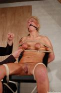 Crystels tit caning and gagged breast punishments tied to a chair in the dungeon