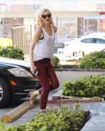 Gwen Stefani busty in white see through top and red leather pants arriving to he