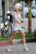 Ashley Tisdale exposing her fantastic legs in short shorts while leaving Barneys