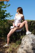 Amateur comely babe peeing upright at the nature
