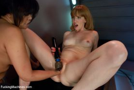 Annie fists Mallory until she squirts, machines fuck Annie's ass until she squir