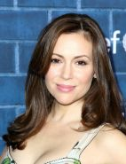 Busty Alyssa Milano wearing a low cut dress at Montblanc  Unicef Pre-Oscar Chari