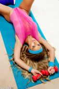 Nicole Aniston showing off her flexibility in aerobics class
