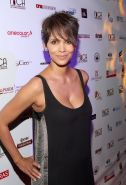 Halle Berry showing big cleavage in a short black dress at 9th Annual Acapulco I