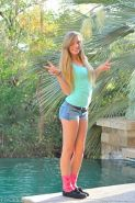 Adorable teen amateur naked and spread by the pool