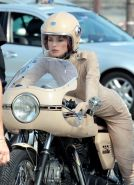 Keira Knightley in tight retro motorcycle suit shooting a commercial in Paris