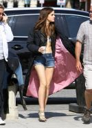 Emma Watson leggy wearing denim shorts  belly top on 'The Bling Ring' set