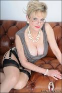High end glamour busty mature babe in stockings and panties