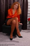 Older redhead Lady Claire in pantyhose