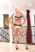 Busty blonde slut Lolly Ink is posing in sexy lingerie and then hotly sucking hu