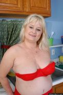Fat mature housewife stripping and masturbating in kitchen