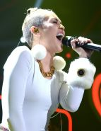 Miley Cyrus wearing white transparent bodysuit at Y100 Jingle Ball 2013 in Miami