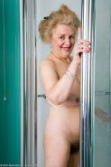 very hairy granny takes a shower and presses huge tits on glass