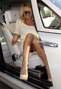 Pamela Anderson showing her panties upskirt in car paparazzi pictures