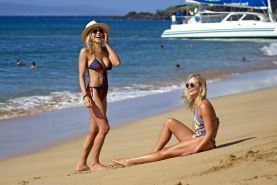 Busty twins wearing tiny swimsuits at the beach in Hawaii