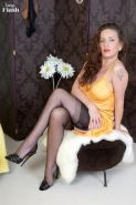 Beauty milf Marlyn Lindsay in her yellow dress and black stockings