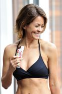 Brooke Burke busty in black bikini top and leggings during the photoshoot by Mic