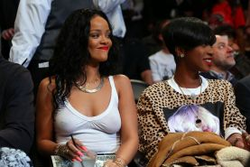 Rihanna shows off her boobs in seethru top at a basketball game in NYC