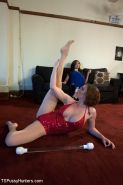 Venus pretends to primp for the evening gown competition while Krissy stretches