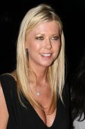Tara Reid nice cleavage in decent black dress