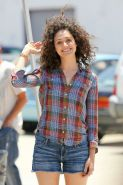 Emmy Rossum wearing denim shorts and some crazy hair on the set of Comet in LA